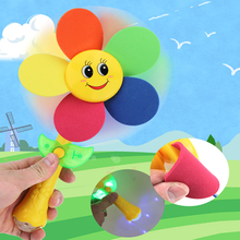 Купить с кэшбэком Electric Sunflower Windmill Rattles Baby Toys 0-12 Months Light Music Rotate Baby Toy Educational Toys Mobile For Baby Cot