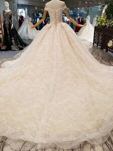 Image 2 - LSS076 trasporto libero veloce abiti da sposa al largo della spalla sweetheart fiori abito di sfera abiti da sposa con il treno lungo reale prezzo