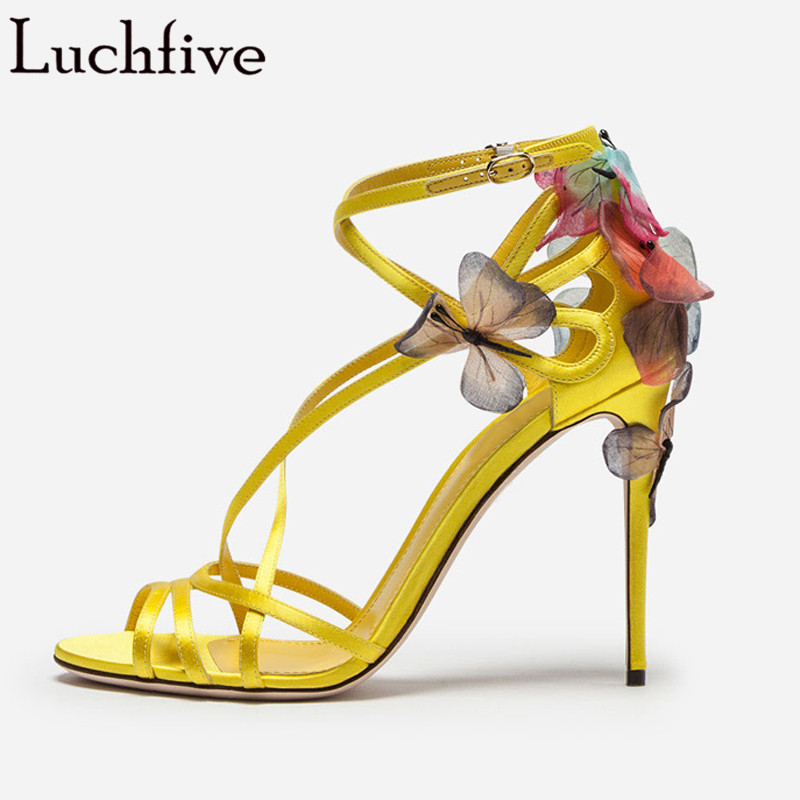 yellow and black high heels