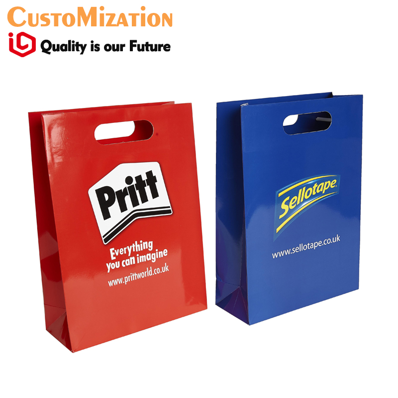 Luxury paper carrier bag with gloss or matt finish and die cut handles multi colour printing