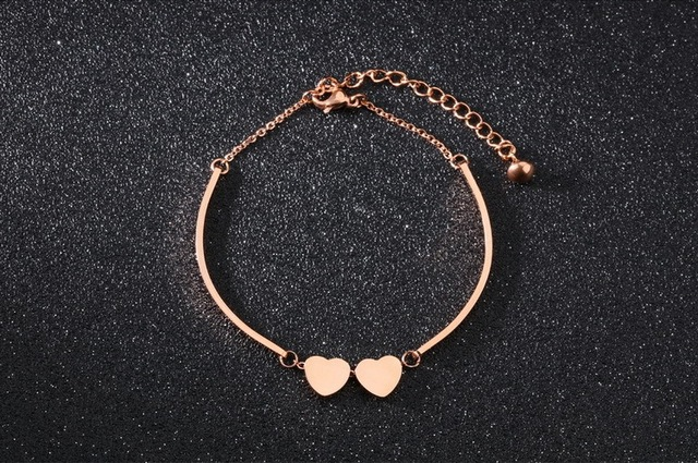 Женский браслет из звеньев цепи цвета розового золота с биркой