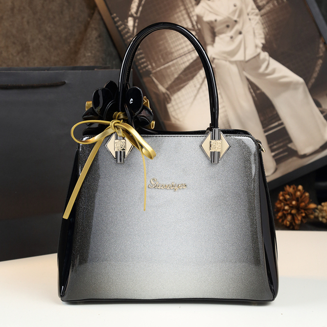 2019 New Luxury Designer High Quality Patent Leather Clutch Top Handle Bags  Handbags Women Famous Brands 581ea1a301