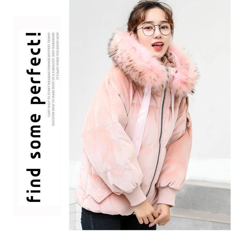 Conception de cape Unique pour l'hiver chaud et l'hiver doudoune femme grand col en fourrure grande capuche femmes vêtements de sortie d'hiver manteaux