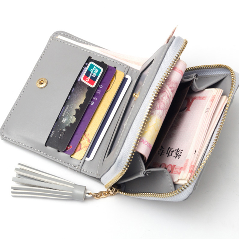 New 2019 tassel ladies short wallet tassel zipper buckle two fold cute small purse vertical section Korean wallet in Wallets from Luggage Bags
