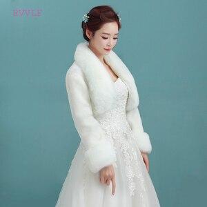 Image 1 - אביזרי חתונה באיכות גבוהה פו הפרווה בולרו ארוך שרוולי שנהב חתונת מעילי חורף חם מעילי כלה חתונה מעיל