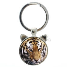 цены 2016 Hot sale wild animal Tiger key chain ring protect save wildlife tiger glass alloy pendant keychain men women jewelry CN262