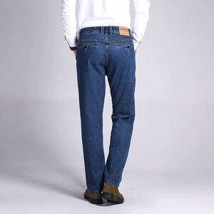 Image 4 - TIGER CASTLE męskie 100% bawełniane grube dżinsy spodnie dżinsowe modne niebieskie workowate męskie kombinezony klasyczne długie jakości wiosenne jesienne dżinsy