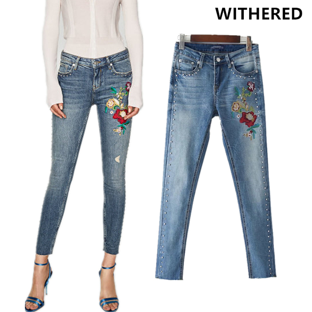 f5d31cbe966 Withered 2017 jeans women vintage floral embroidery Rivet trim washed high  waist skinny push up pencil jeans women plus size