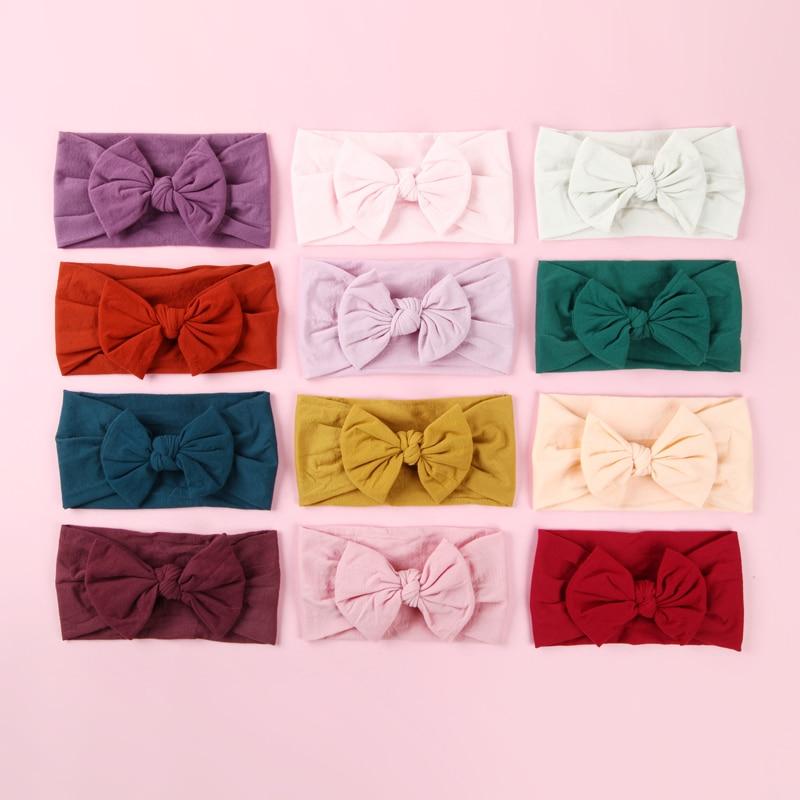 100 pcs lot Wholesale knot bow nylon headbands Wide Nylon Bow Headwraps with Pompom Trim Round