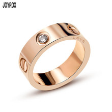 Фотография JOYROX 2017 New Fashion Rose Gold Titanium Steel Ring For Women Men Charm Crystal Couple Lovers Ring Jewelry Free Shipping