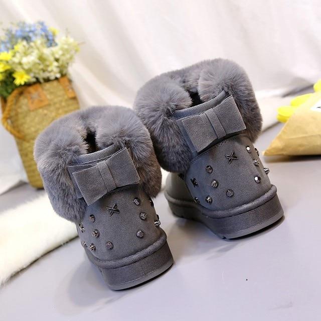 女性のブーツ 2018 冬の新プラスベルベット厚い雪のブーツ女性の厚い底ショート女性の足首弓学生ブーツ