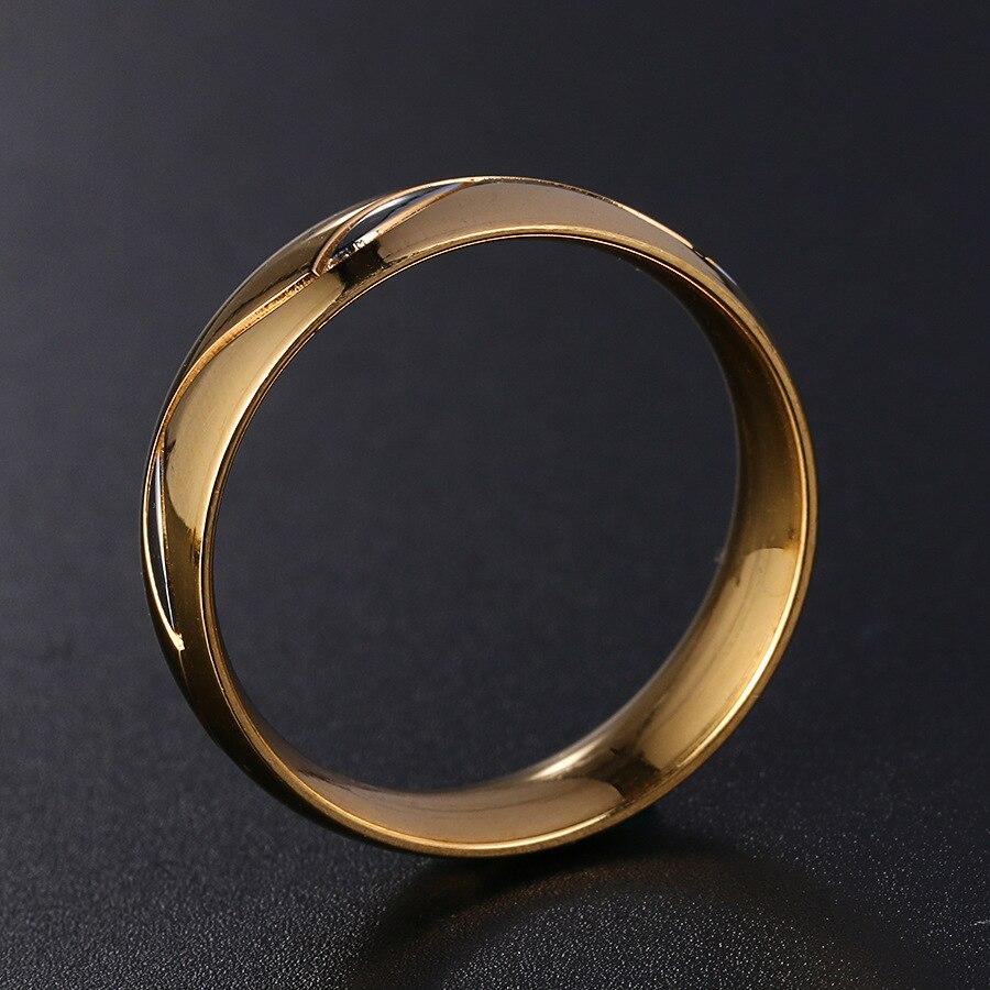 eb9f8576f5c2 Los hombres de moda de Europa joyería oro color negro amantes concisa grabado  anillos de acero inoxidable para hombres y mujeres en Anillos de Joyería y  ...