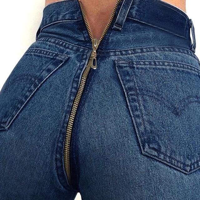 la mujer en para con espalda Pantalones cremallera 0kwOPn