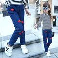 Bebé de Los Pantalones Vaqueros de invierno chica caliente pantalones de mezclilla de Dibujos Animados labios niñas jean pantalones niños jeans ropa de los cabritos Envío gratis