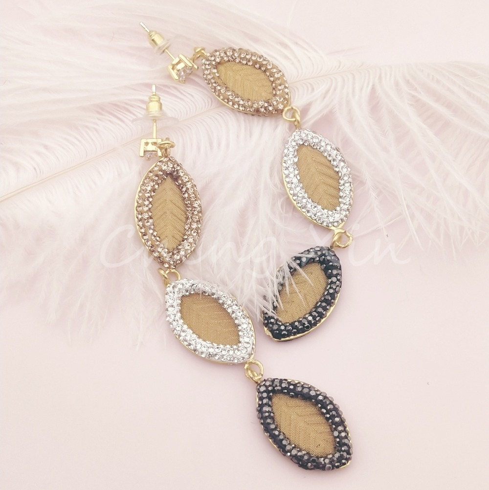 A pair of jewel encrusted gold fashion earrings in Drop Earrings from Jewelry Accessories