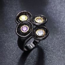 Женское кольцо с оливином Черное круглое фиолетовым кристаллом