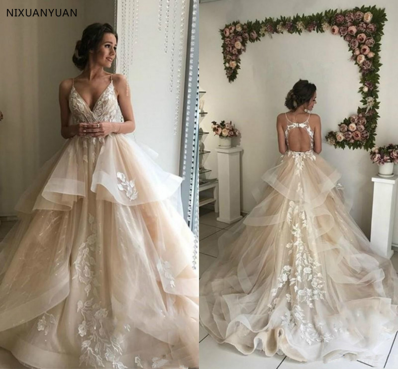 2019 Champagne Elegant A Line Spaghetti Lace Wedding Dresses Tiered Ruffle Flowing Lace Applique V Neck Bridal Wedding Gowns