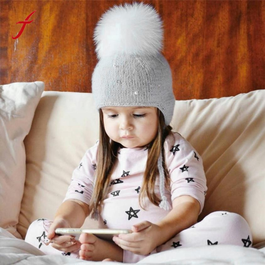 2017 New Fashion Keep Warm Boy Girl Hair Ball Earbud Hat Child Print Knit Hat Autumn And Winter Girl's hats Boy's cap Hats rabbit hair lady autumn winter new weaving small pineapple fur hat in winter to keep warm very nice and warm comfortable