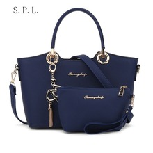 S.P.L. new 2017 fashion functional bag keychain decorative small famale shoulder bag handbag leather top handle bag with purse