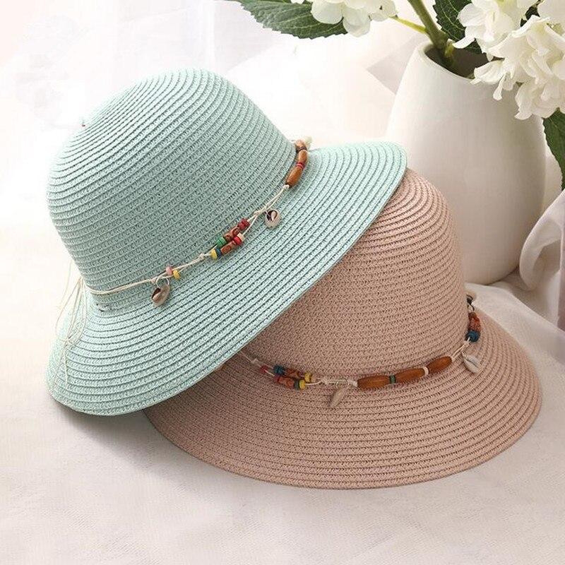Hot baru musim panas busana wanita lady lebar tepi pantai matahari topi  shell liontin elegan topi jerami lembut kulit Bohemian wanita kencan di Topi  ... 4f40391976
