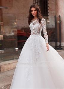 Image 2 - Aantrekkelijke Tulle Jewel Hals See Through Lijfje A lijn Trouwjurk Met Kant Applicaties & Staaflijst Lange Mouwen Bridal Dress