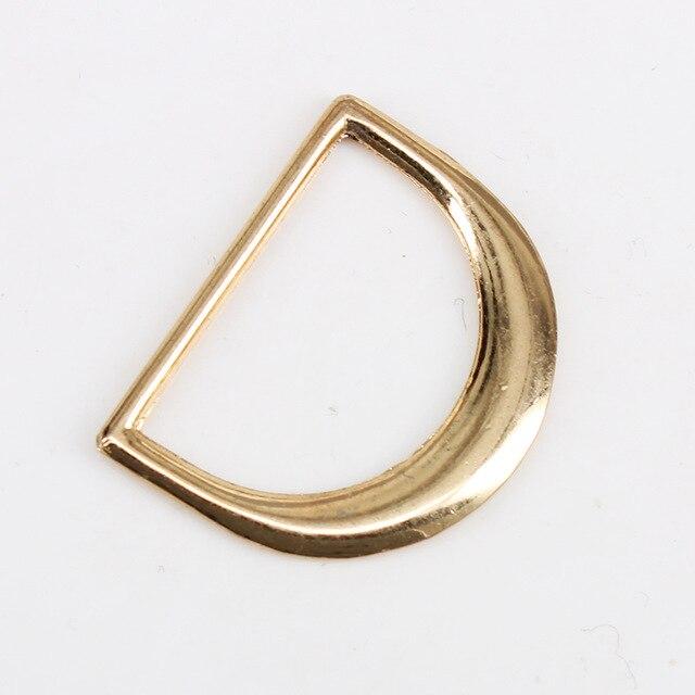 50 pièce 25mm Gold Tone Métal D Anneau Ceinture Boucle pour Sac À Dos  Sangles Bagages Vêtement Attaches Accessoires Artisanat K407 c1472aa04f1