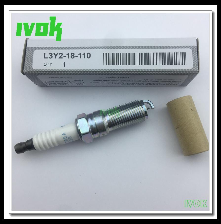 Prix pour 4 pièces/lot Haute Qualité Japon Iridium spark plugs L3Y2-18-110 Pour NGK ILTR5A-13G POUR MAZDA M6 M5 M3 CX-7 Ford Lincoln hommage
