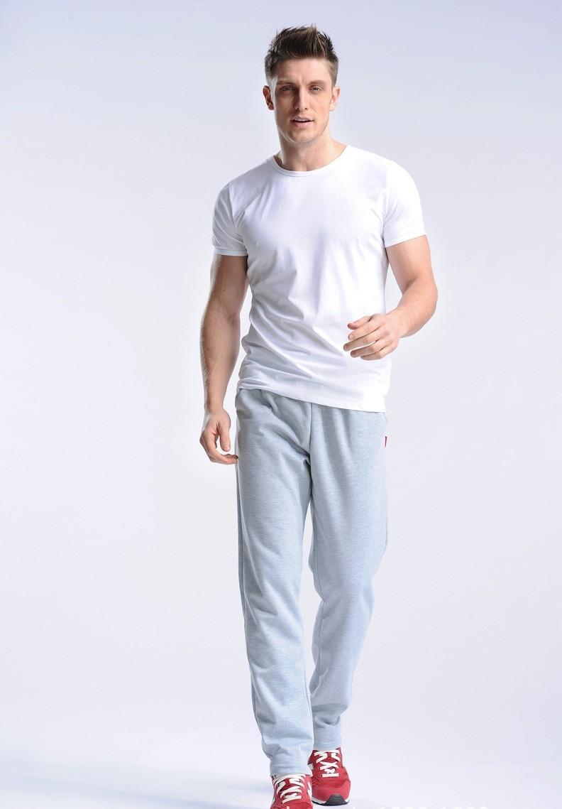 Uwback 17 Plus Size 4XL New Sweat Pants Men Joggers Pants Elastic Waist Loose Sweat Pants For Men Casual Trousers homme CAA329 14