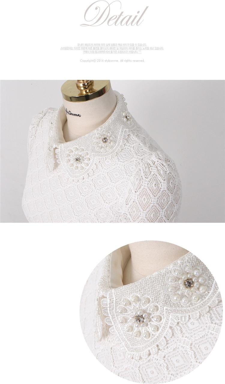 Pärlitega kaunistatud valge pidulik pluus