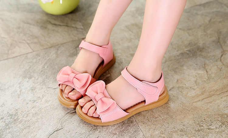 Cô gái Hàn Quốc trẻ em giày cô gái mùa hè dép miệng cá dép trẻ em lớn trẻ em cúi bãi biển công chúa giày trắng hồng