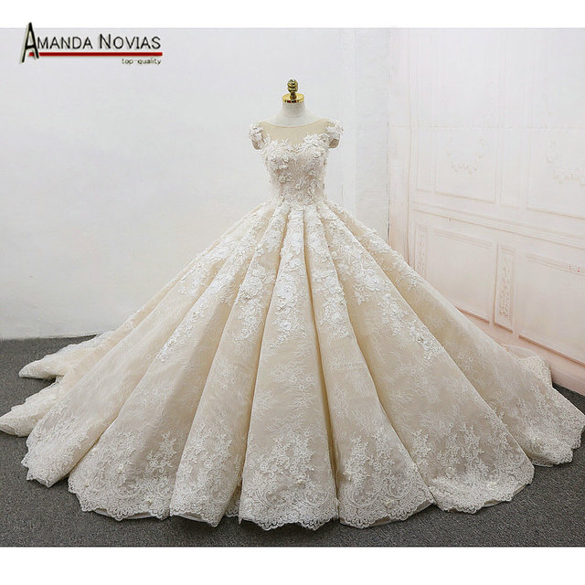 2ca78bb7fcd Amanda Novias bruidsjurken Cap Sleeve Lace Appliqued Flowers Luxury Wedding Dress  Pleated