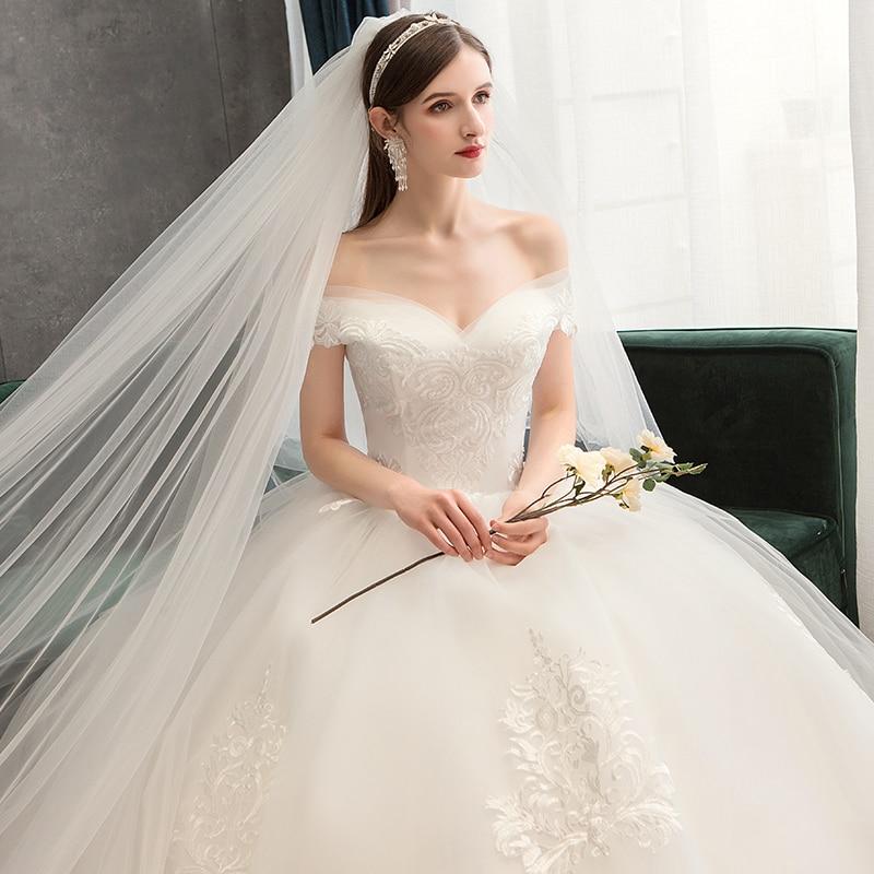 Sexy Sweetheart Lace Ball Gown Boat Neck Wedding Dresses 2019 Applique Beaded Flowers Chapel Train Bride Gown Vestido De Noiva