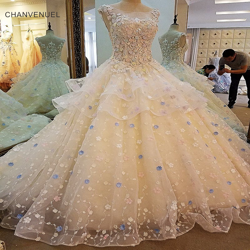 Ls00046 gorgeous champagne bridal gown colorful flowers for Flowers for champagne wedding dress