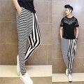 Мужчины полосой брюки асимметрии черный белой полосой случайные штаны низкий промежность гарем брюки свободные брюки