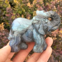 Small elephants carved from natural labrador stone are used as home decoration