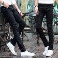 Na primavera de uma explosão de jeans preto estudantes juventude estiramento magro lápis calças jeans maré