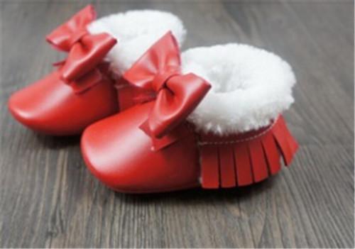 Nueva suela de goma dura franja arco mocasines de piel de bebé Primeros Caminante niño caliente del bebé del invierno botas de nieve niño Zapatos de las muchachas con la piel
