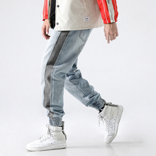 купить 2018 High Street Fashion Men Jeans Light Blue White Wash Stripe Spliced Tapered Pants Punk Style Jogger Pants Hip Hop Jeans Men по цене 2062.71 рублей