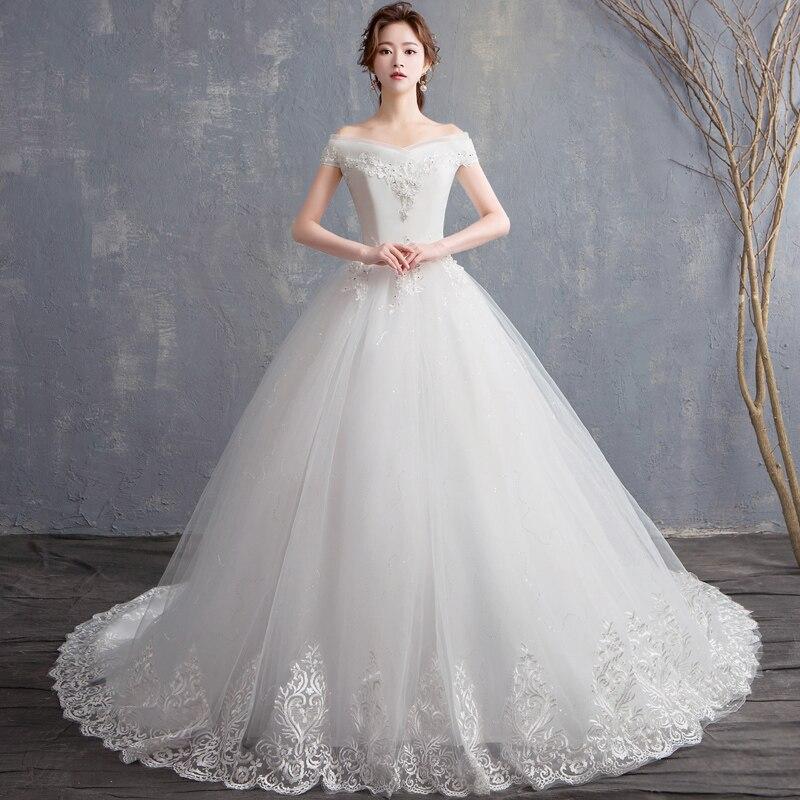 Pas cher en Stock robes de mariée nouveaux Vestidos de novia col bateau petit Train dentelle broderie manches courtes robe de mariée robes