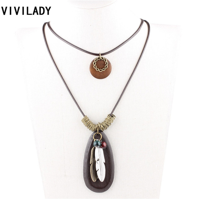 Vivilady fashion new design handmade alloy feather wreath beads vivilady fashion new design handmade alloy feather wreath beads wood pendants long tassels necklaces women sweater mozeypictures Images