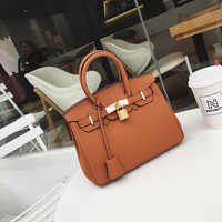 2018 fashion platinum bag manual lock OL commuter hand shoulder slung female handbag wholesale solid color custom
