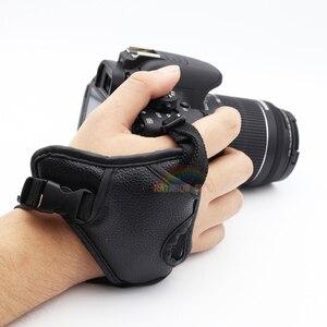 Image 2 - جلد طبيعي المعصم اليد حزام أسود جلد كاميرا اليد حزام قبضة عالية الجودة الثلاثي SLR/DSLR كاميرا جلدية حزام لينة