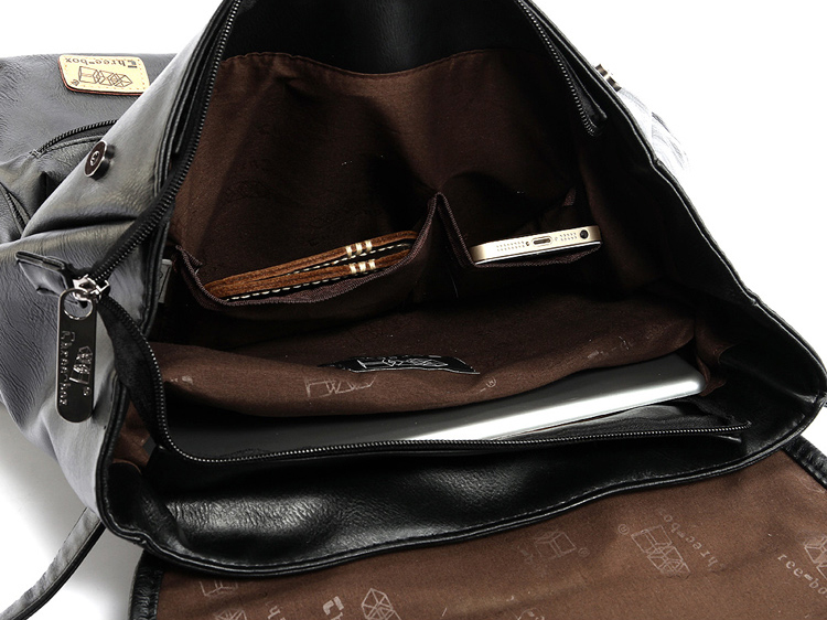 photo showing the internal capacity of a black vintage backpack made with leather
