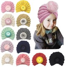 New baby knitted childrens hat Baby solid color hair accessories donut wool cap caps for selection