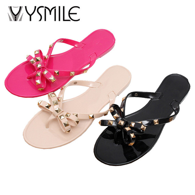 ee00a3a4175 Free shipping rivets bow slippers women jelly shoes ladies beach flip flops  solid color flip-flop slipper shoes 2017 summer