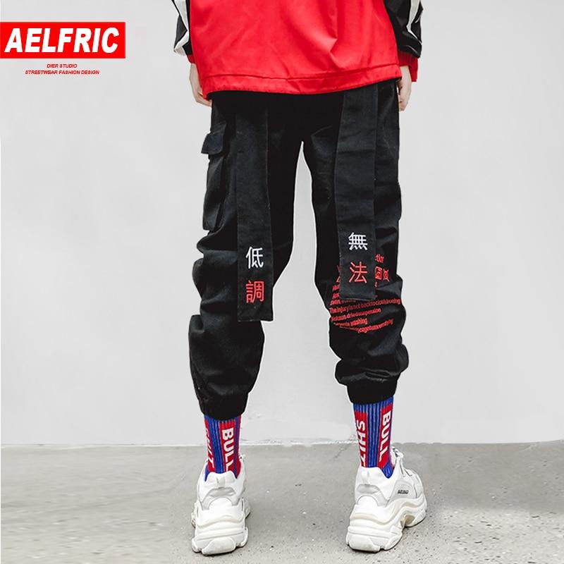AELFRIC Chinese Letter Embroidery Ribbons Casual Pants Men Trouser 2018 Autumn Winter Harajuku Harem Joggers Sweatpants KJ170(China)