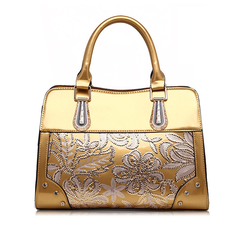 PU handbags new handbags high-grade patent leather mobile handbags shoulder bag Europe and the United States fashion sequins 2018 new europe and the united states stitching shoulder messenger bag spring and summer fashion personalized pu rivet handbags