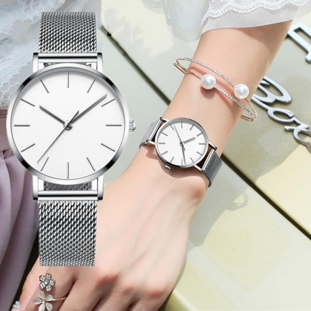 Dropshipping nueva tendencia malla de acero inoxidable mujeres Reloj  hombres moda de lujo Simple relojes mujer 721cb414e9d8