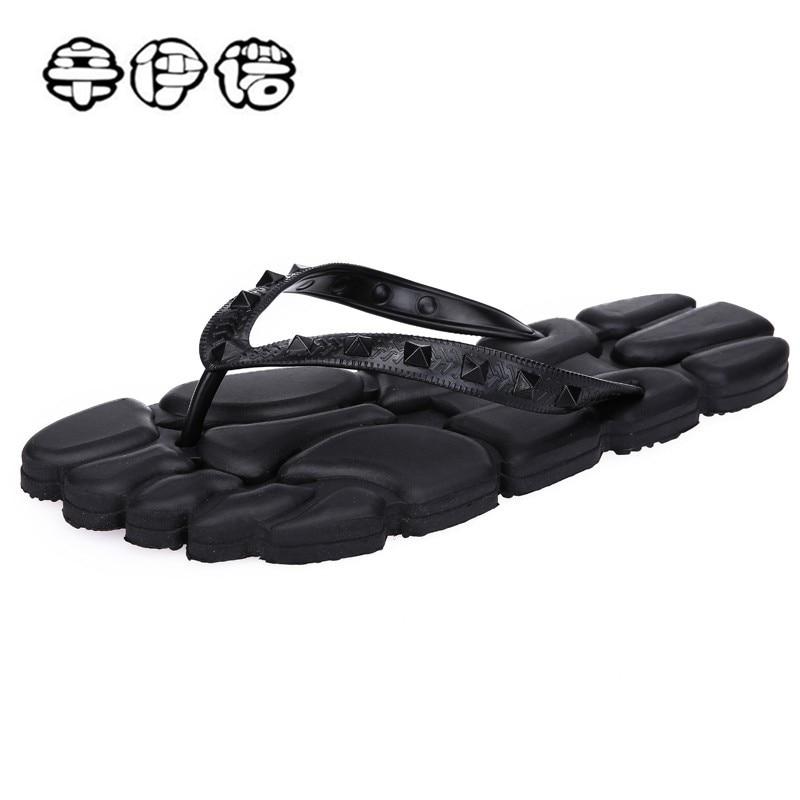 China Masajeador Sandalias Acupresión Zapatillas Pie Para Masaje Baratas Terapia Hombres Acupuntura Pies Giratorio Zapatos Negro T0gqwEn