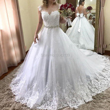Luxury Shiny Ball Gown Lace Applique Wedding Dresses with Beading Sash 2021 Scoop Cap Sleeve Chapel Train Wedding Formal Dress